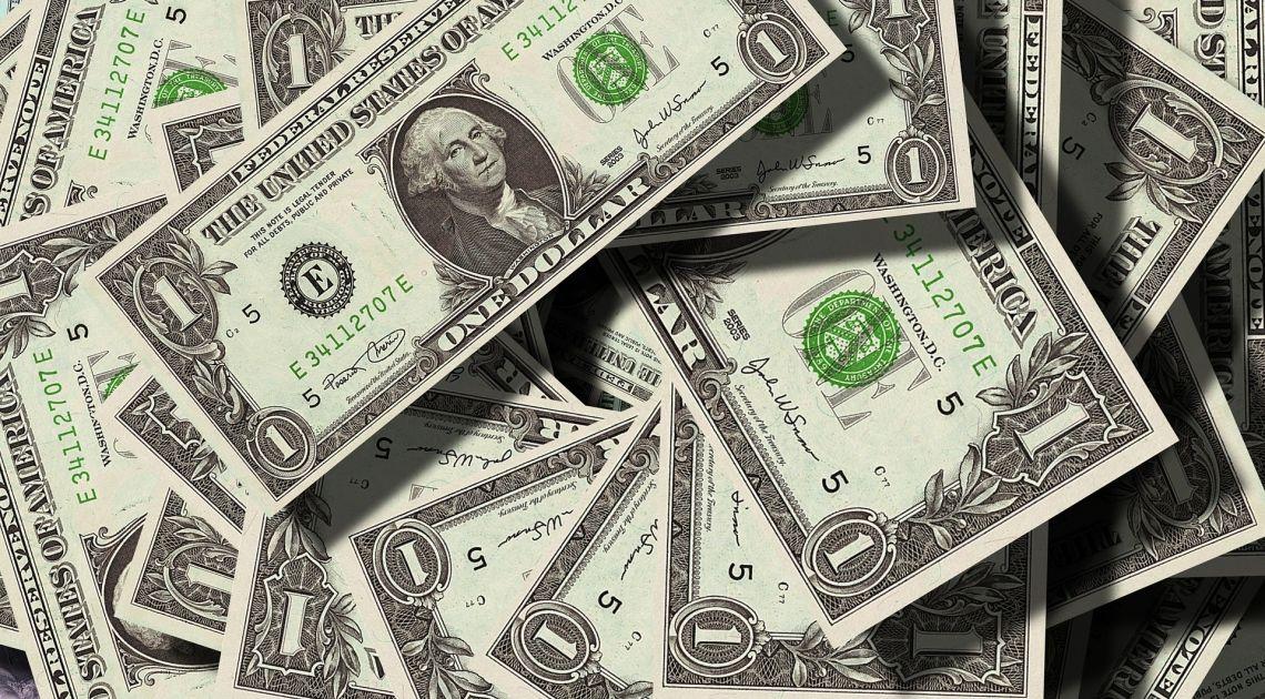 El dólar resentido por recortes de tipos de la Reserva Federal